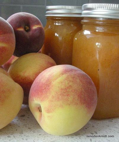 peaches and jars of peach jam